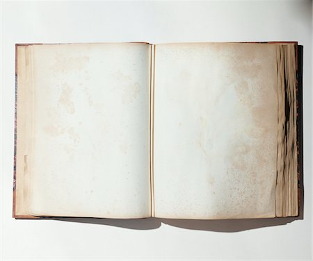 spot (dirt mark) - Blank pages in open antique book Stock Photo - Premium Royalty-Free, Code: 6106-05460850