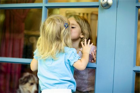 dog kissing girl - Two sisters (20 months-3) kissing each other through French door Stock Photo - Premium Royalty-Free, Code: 6106-05462402