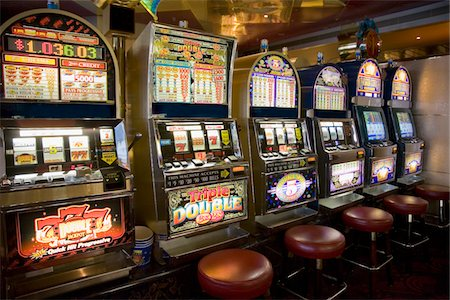 front row seat - Row of slot machines on cruise ship Stock Photo - Premium Royalty-Free, Code: 6106-05462550