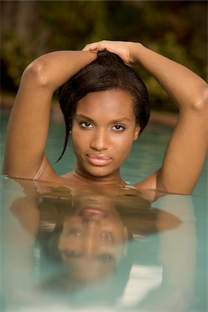 Portrait of a naked young woman in a swimming pool Stock Photo - Premium Royalty-Free, Code: 6106-05466740