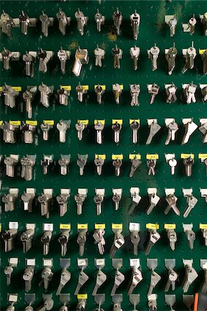 Rows of keys hanging on hooks Stock Photo - Premium Royalty-Free, Code: 6106-05471165