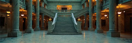 This is the interior of the State Capitol of Utah. Marble Columns are at the sides of a very wide, grand staircase leading to the second floor. Stock Photo - Premium Royalty-Free, Code: 6106-05472497