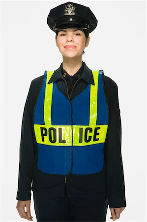 female police officer happy - Traffic police officer on white background, portrait Stock Photo - Premium Royalty-Free, Code: 6106-05476588