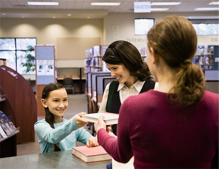 education loan - Mother and daughter (8-9) taking out books from library Stock Photo - Premium Royalty-Free, Code: 6106-05485539