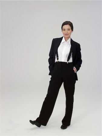 Mature woman wearing trouser suit, smiling, portrait Stock Photo - Premium Royalty-Free, Code: 6106-05486051