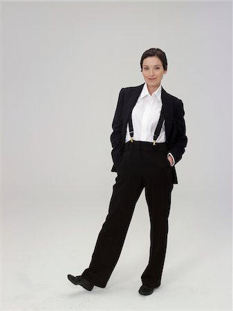 Mature woman wearing trouser suit, smiling, portrait Stock Photo - Premium Royalty-Free, Code: 6106-05486051