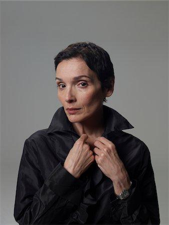 Mature woman wearing black top, portrait Stock Photo - Premium Royalty-Free, Code: 6106-05486099