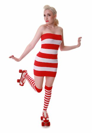 roller skate - Caucasian model wearing a red and white striped dress and socks with roller skates Stock Photo - Premium Royalty-Free, Code: 6106-05486551