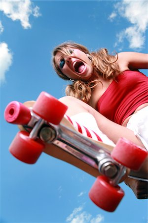 roller skate - Angry woman about to stomp on her prey with her roller skate Stock Photo - Premium Royalty-Free, Code: 6106-05486507