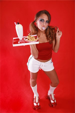 roller skate - Retro-looking car hop waitress holding a tray with a milkshake, hotdog and fries Stock Photo - Premium Royalty-Free, Code: 6106-05486514
