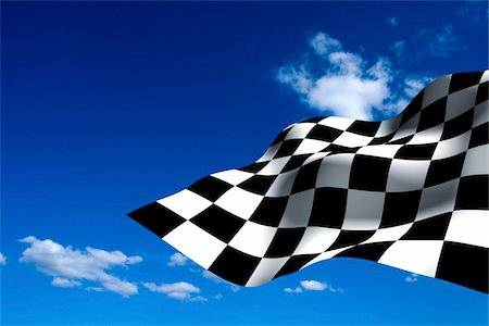 Car Racing checkered flag on blue sky. Stock Photo - Premium Royalty-Free, Code: 6106-05486720