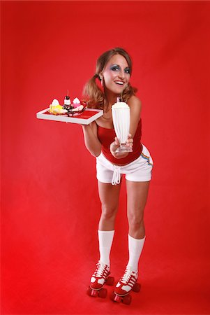 roller skate - Roller waitress serving a milkshake. Stock Photo - Premium Royalty-Free, Code: 6106-05487014