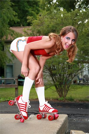 roller skate - A beautiful model in roller skates pulling up her tube socks. Stock Photo - Premium Royalty-Free, Code: 6106-05487026