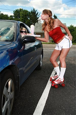 roller skate - Roller waitress serving a milkshake and a hot dog to a customer. Stock Photo - Premium Royalty-Free, Code: 6106-05487029