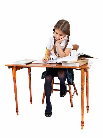 school girl uniforms - Girl doing her homework. Stock Photo - Premium Royalty-Free, Code: 6106-05488061