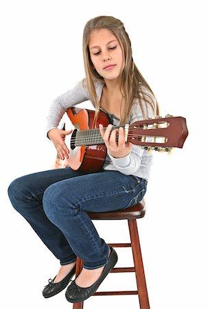 preteen girl - Girl playing guitar. Stock Photo - Premium Royalty-Free, Code: 6106-05488078
