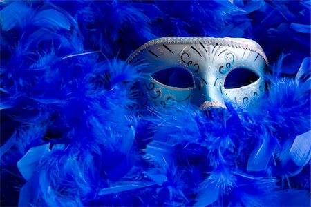Venetian mask among bright blue feathers. Stock Photo - Premium Royalty-Free, Code: 6106-05488552