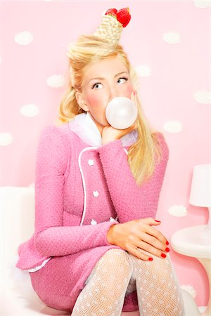 Girl in pink with bubblegum Stock Photo - Premium Royalty-Free, Code: 6106-05488615
