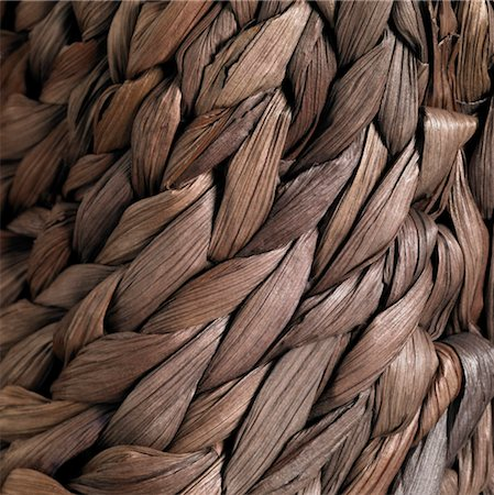 Detail of a plaited bag made of natural fiber Stock Photo - Premium Royalty-Free, Code: 6106-05488723