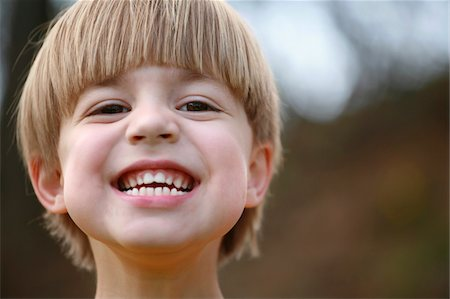 A cute 4 year-old boy with a big grin on his face. Stock Photo - Premium Royalty-Free, Code: 6106-05489821