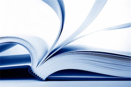 page - Close-up of an open book with flipping pages.  Blue-toned. Stock Photo - Premium Royalty-Free, Code: 6106-05490093