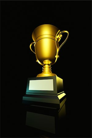 Golden trophy on black background. Stock Photo - Premium Royalty-Free, Code: 6106-05490879