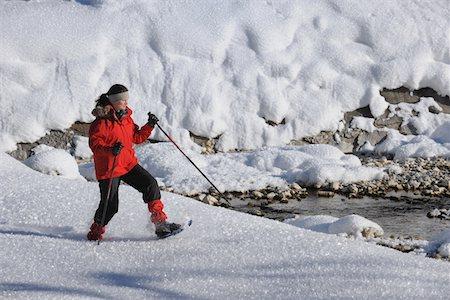 Woman (35-40J) with snow shoes walking through winter landscape. Berwang, Tirol, Austria. Stock Photo - Premium Royalty-Free, Code: 6106-05491523