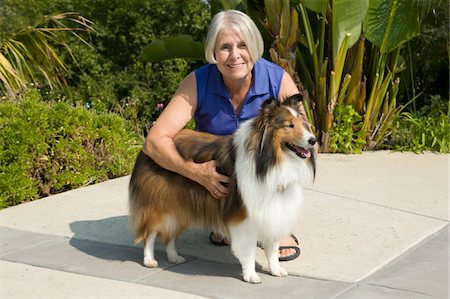 sheltie - Mature woman with her dog Stock Photo - Premium Royalty-Free, Code: 6106-05493221