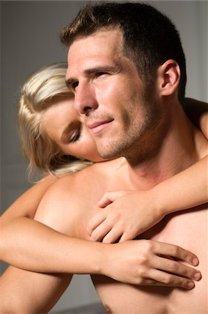 Young couple naked embracing Stock Photo - Premium Royalty-Free, Code: 6106-05496568
