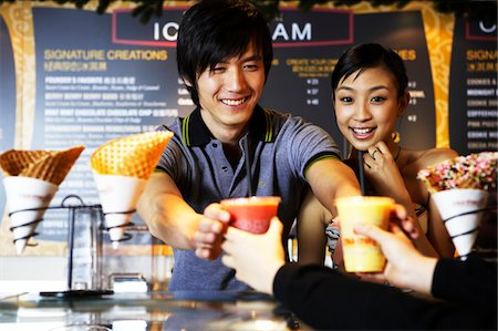 Man and woman getting beverages at retail store Stock Photo - Premium Royalty-Free, Code: 6106-05496768