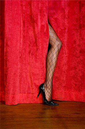 sexy women legs - Woman's leg in fishnet stockings on stage Stock Photo - Premium Royalty-Free, Code: 6106-05497042