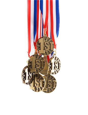 Bunch of 1st place medals Stock Photo - Premium Royalty-Free, Code: 6106-05497167