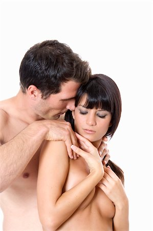 Young couple embracing Stock Photo - Premium Royalty-Free, Code: 6106-05497502