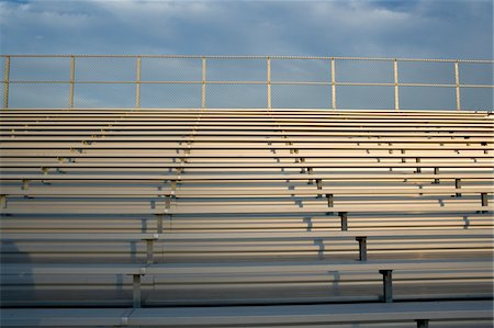 front row seat - Stadium bleachers, benches Stock Photo - Premium Royalty-Free, Code: 6106-05498733