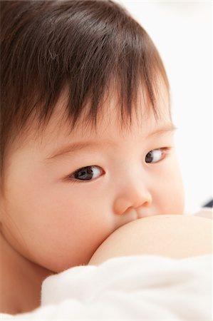 Do the suck of the baby of milk. Stock Photo - Premium Royalty-Free, Code: 6106-05402490