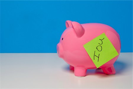 "Piggy bank with ""IOU"" note Stock Photo - Premium Royalty-Free, Code: 6106-05402809"