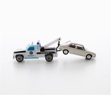 Toy police tow truck. Stock Photo - Premium Royalty-Free, Code: 6106-05403442