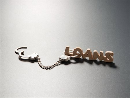 "Handcuffs and ""LOAS"" sign Stock Photo - Premium Royalty-Free, Code: 6106-05403648"