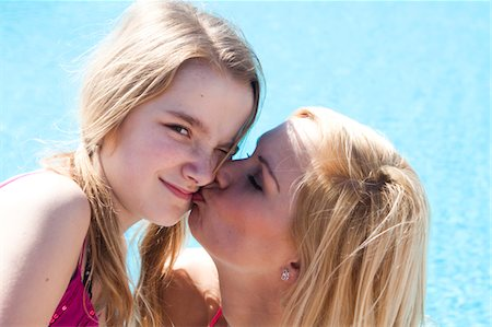 preteen kissing - holiday Stock Photo - Premium Royalty-Free, Code: 6106-05403994