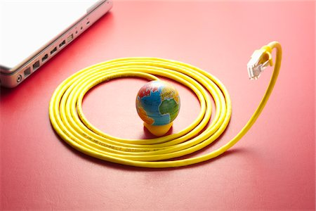Yellow LAN cable and a globe. Stock Photo - Premium Royalty-Free, Code: 6106-05403909