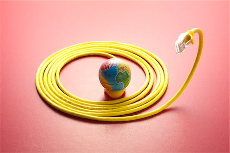 Yellow LAN cable and a globe. Stock Photo - Premium Royalty-Free, Code: 6106-05403925