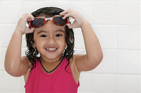 Little girl with swim goggles. Stock Photo - Premium Royalty-Free, Code: 6106-05404094