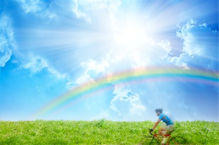 rainbow - Man bicycling in the countryside Stock Photo - Premium Royalty-Free, Code: 6106-05404342