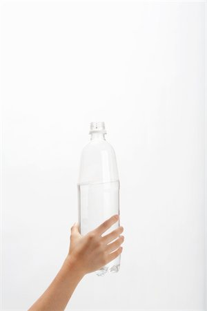 Hand of child who has PET bottle Stock Photo - Premium Royalty-Free, Code: 6106-05405632
