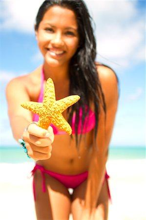 hispanic bikini girl with starfish Stock Photo - Premium Royalty-Free, Code: 6106-05405724