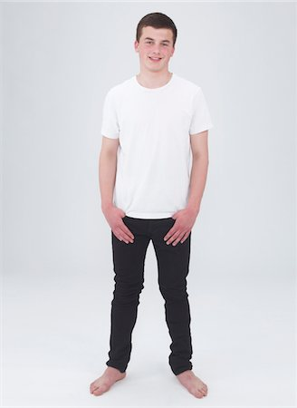 young male smiling with arms crossed Stock Photo - Premium Royalty-Free, Code: 6106-05405852