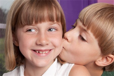 Sister Gets Kiss From Little Brother Stock Photo - Premium Royalty-Free, Code: 6106-05406997