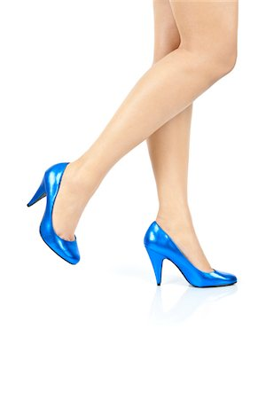Women Legs Blue Shoe Moving Stock Photo - Premium Royalty-Free, Code: 6106-05407161