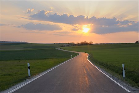 roads and sun - Empty single track road through fields. Stock Photo - Premium Royalty-Free, Code: 6106-05407700
