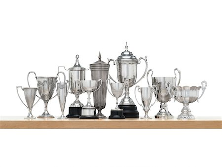 11n Silver trophies on maple shelf Stock Photo - Premium Royalty-Free, Code: 6106-05408626